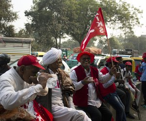 Satvir Singh, 61, third from the left, stops for a tea break on his way to Ramlila Maidan.