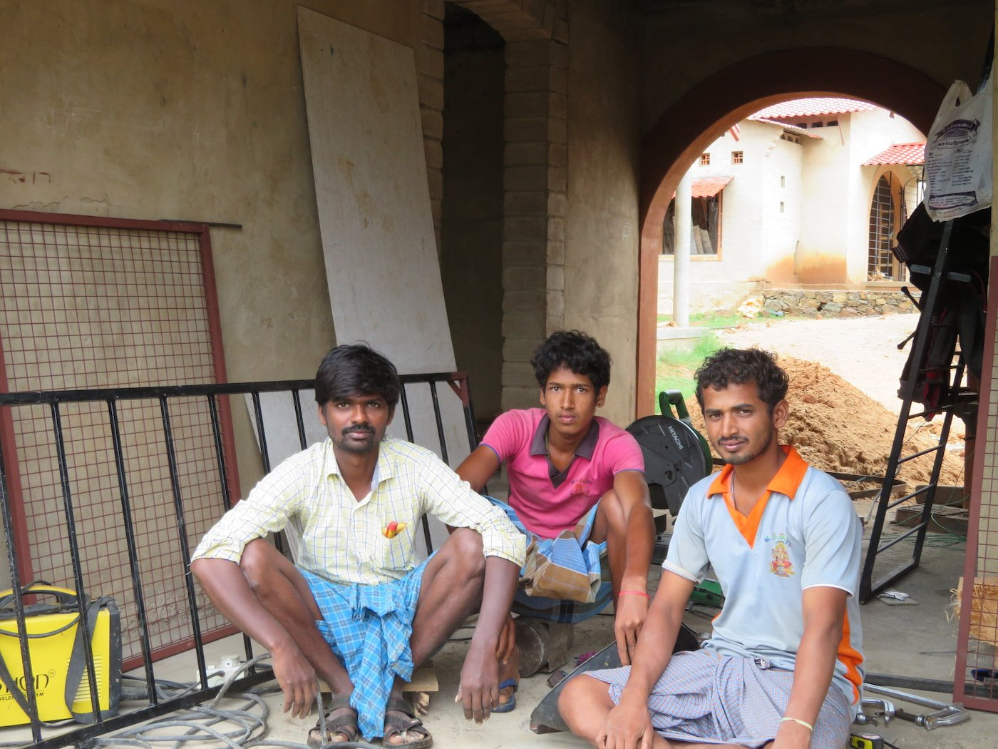 Perumal, Sriram and Kumar (left to right) building a new school campus
