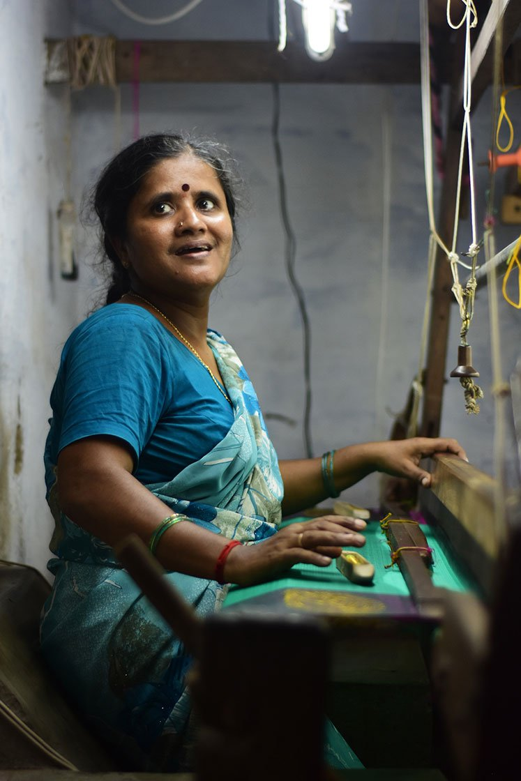 Nirmala uses multiple shuttles for complex saree designs