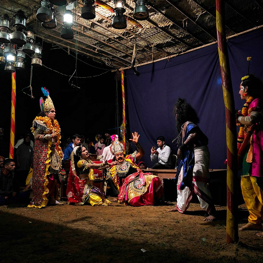 Artists are performing Dashavatar play outside the temple premises