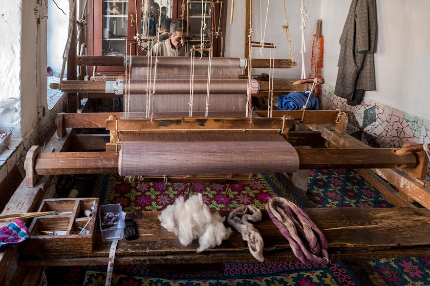 Mohammed Sidiq Kotha and his son Irshad Ahmed Kotha have been hand-weaving pashmina shawls on the charka for decades. They that the speed of machine-woven shawls is hard to compete with