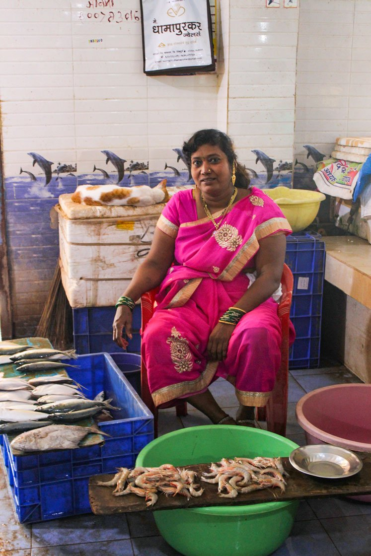 Left: Manisha Jadhav, head of the local fisherwomen's association, Sindhusagar Macchi Vikri Mahila Sanghatna, Malwan, exudes confidence as she sits with her fish in the market. Right: Women of the community