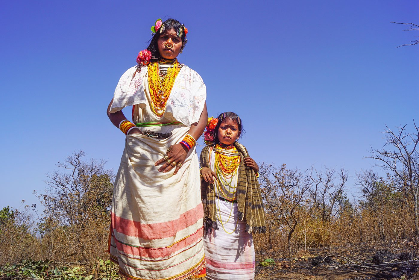 A tribal woman and a young tribal girl in their traditional attire