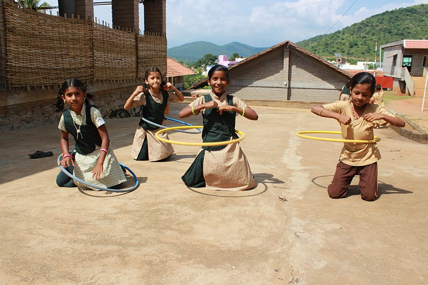 four girls playing with hoops