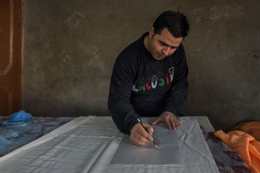 Shabir Butt, now in his mid-30s, learnt to make designs on pashmina shawls from his father, and has been in the trade since he was 15. Though the drawings are now computerised in many places, he prefers to continue drawing by hand.