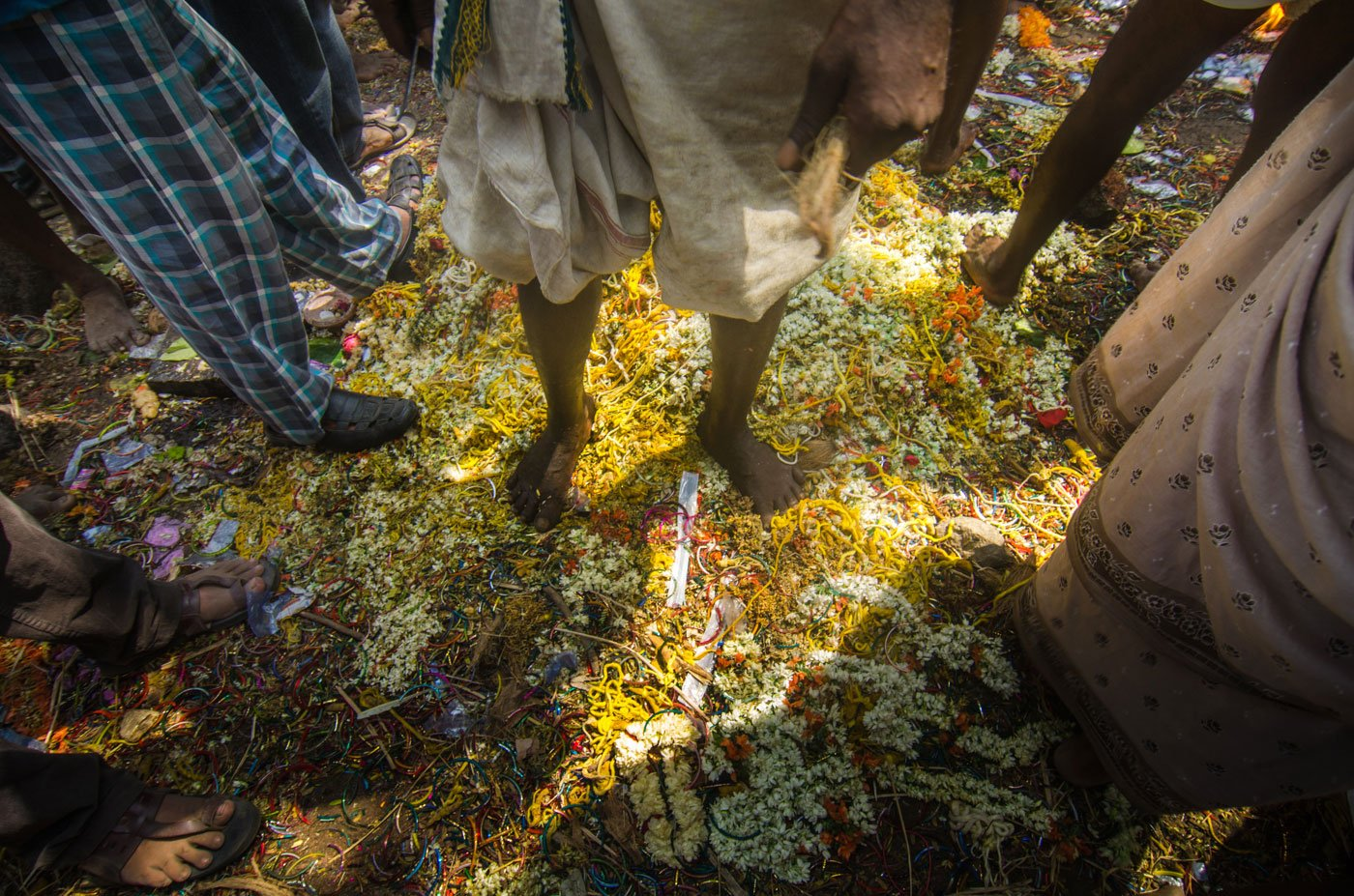 Near the temple are the remnants of what used to be signs of marriage – scattered garlands, broken bangles and cut up thalis