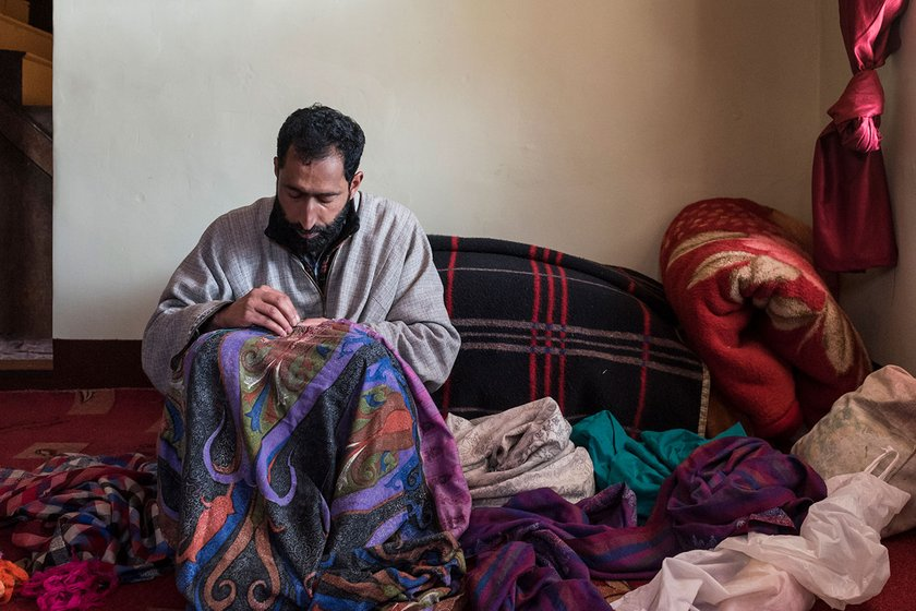 Nazir Ahmed, a master artisan, embroidering a pashmina shawl with his sui-dhaga  in Ganderbal.  A shawl fully covered with designs can take even up to 6-8 months, while a plain one with an ornate border might take a month at most.