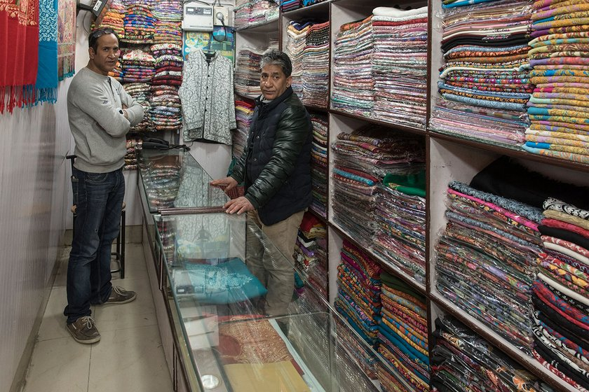 Niaz Ahmed, the owner of a pashmina shawls shop in Lal Chowk, Srinagar,  has been in pashmina trade for decades and says he has seen good times when the demand of pashmina was good as were his profits. Mashqoor Sheikh, now 44 has been in family' pashmina business since his teens, and shifted from weaving to wholesale to try and earn more
