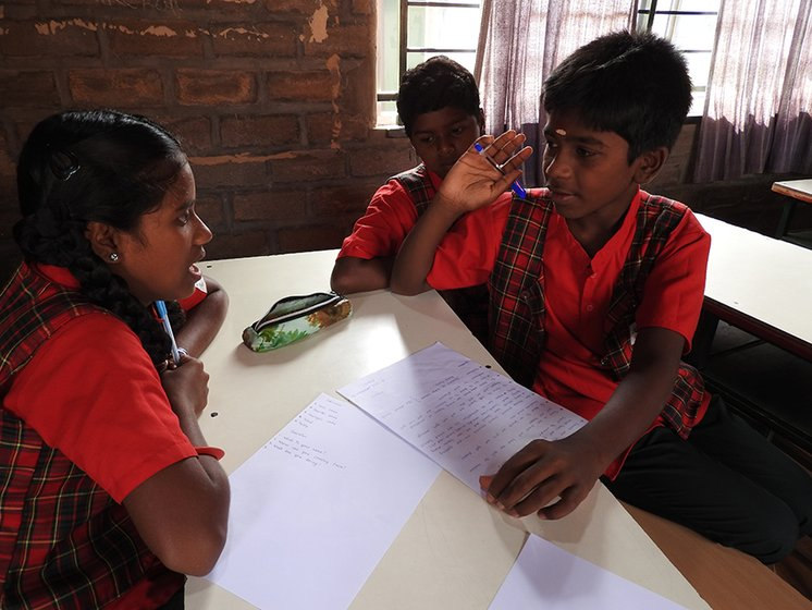 Left: Senior students, Vindhya and Aravali, are preparing the newspaper that will come out on 'Project Day' on November 27. During discussions with group members, they are highly focussed, jotting down important points in their neat handwriting