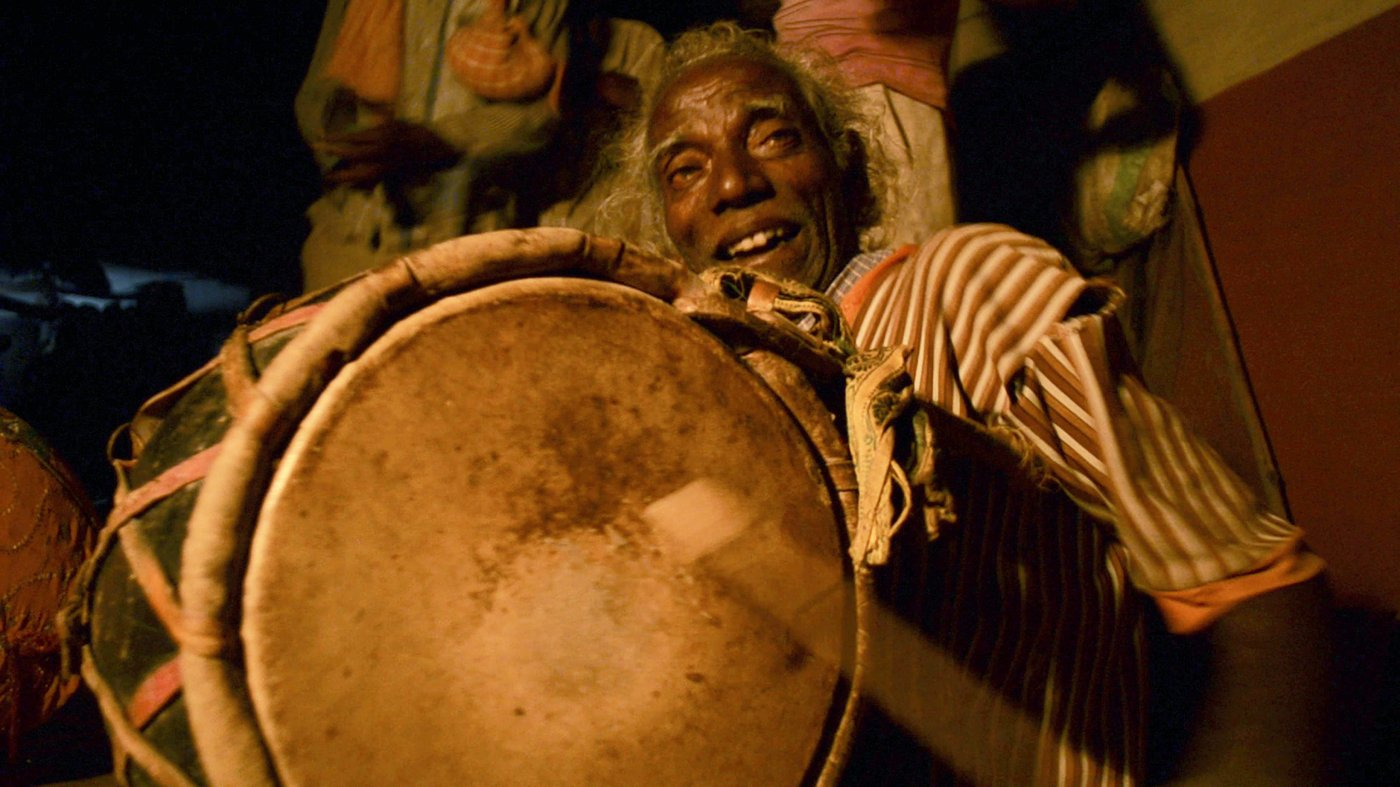 Man playing traditional instruments