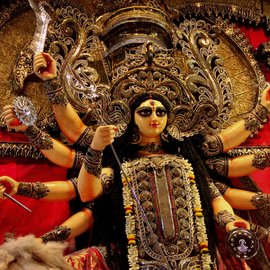 An idol of Ma Durga being readied