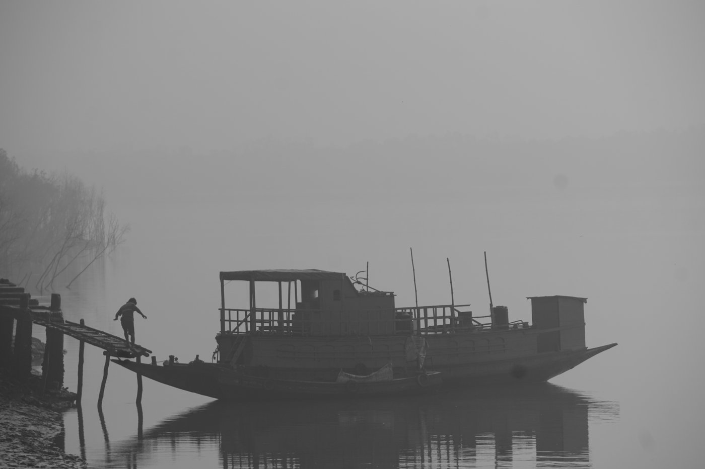 Man getting on ferry on a foggy day