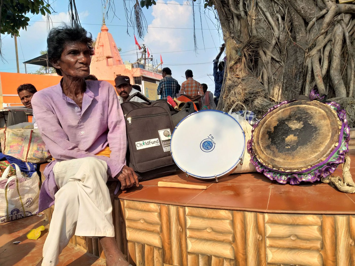 Troupes of musicians from western Odisha are gathered at the Budha Talaab square in Raipur.