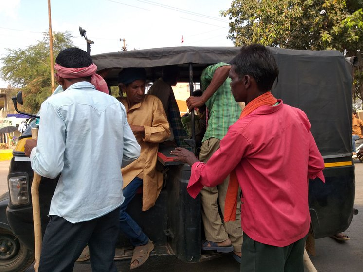 People from Achhoti are taking the musicians to the village in an autorickshaw