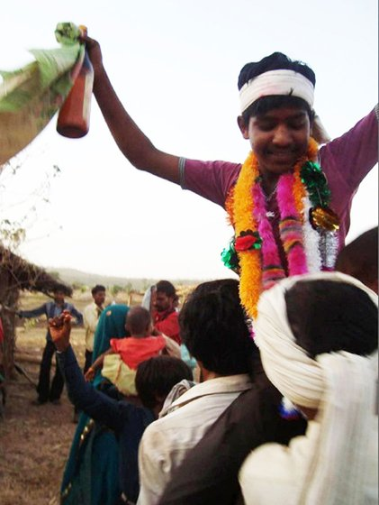 Marriage is an occasion for celebration and the young bridegroom has been lifted up on the shoulders of one of his dancing kinsmen