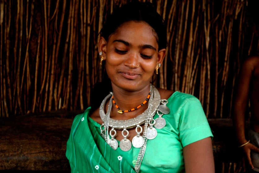 An Adivasi bride wearing traditional silver jewellery in preparation for marriage