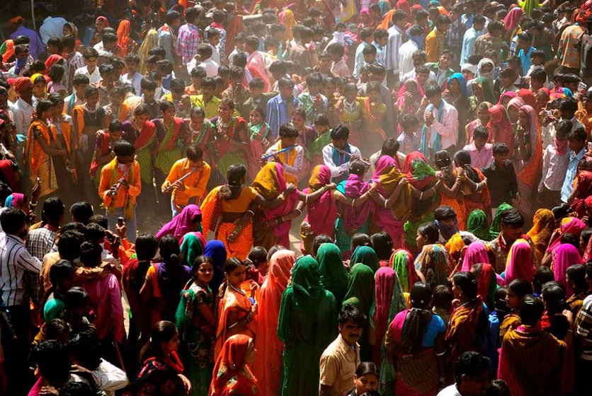 Adivasis in Bakhatgarh village dancing during the colorful Bhagoria festival, which celebrates the kharif harvest just prior to Holi in spring