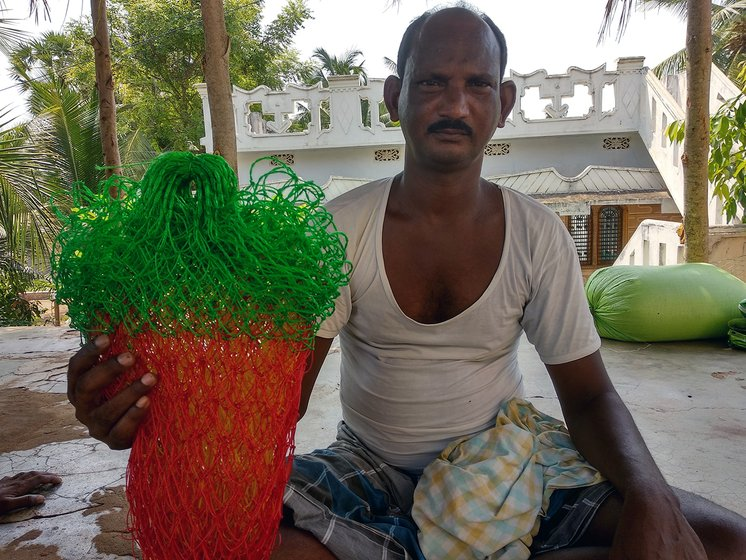 Man working on fish net