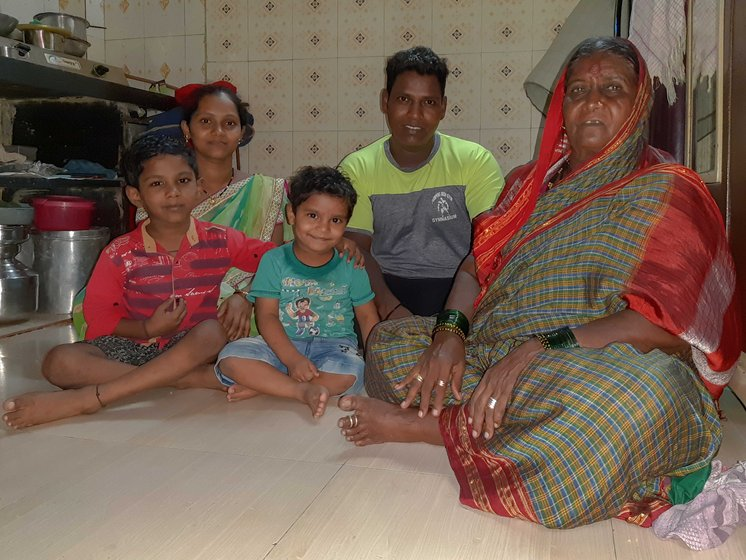 Balappa Chandar Dhotre's family members sitting together in their house