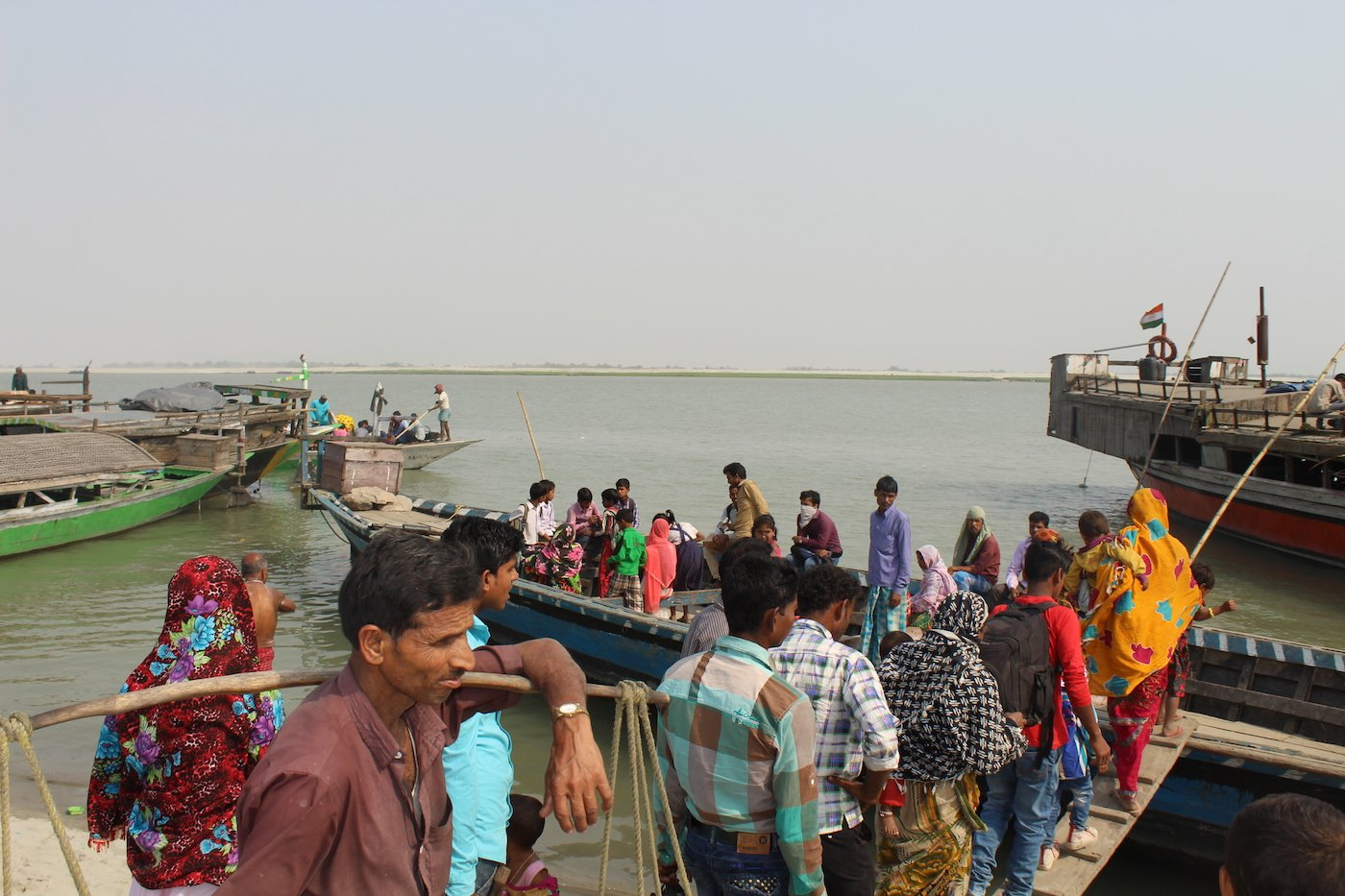 People taking boats to travel from Dhubri to Birsing