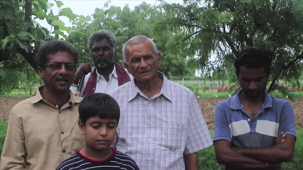 Hiteshkumar Patel (far left) of Davda village with other villagers