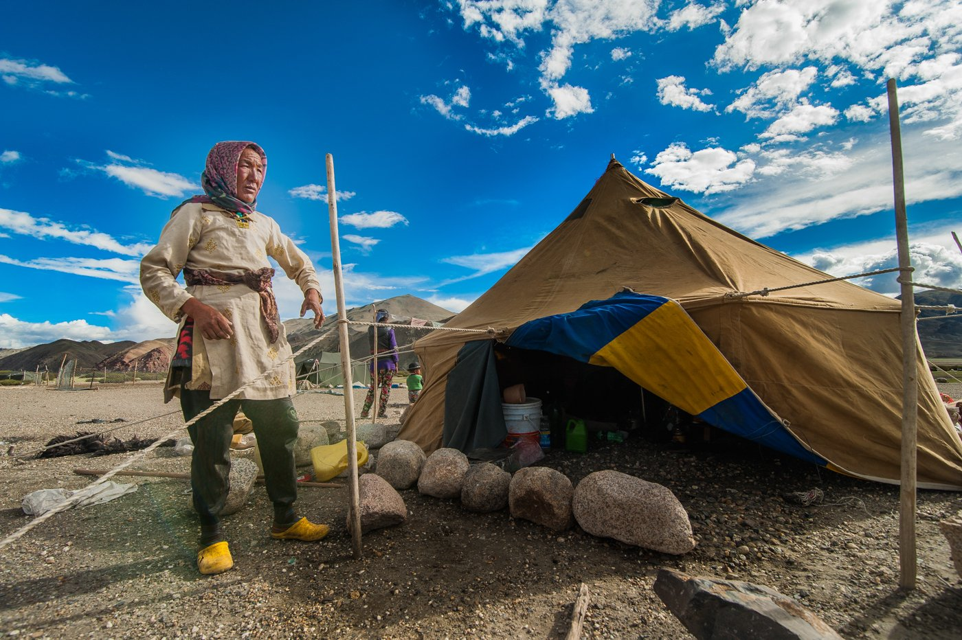 Dohna pitching her family's tent in a highland summer pasture in Hanle valley, Ladakh
