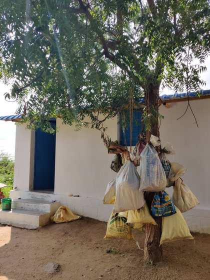 Left: Sacks containing vessels for the menstruating women are hung from the branches of a neem tree that stands between the two isolated rooms in Koovalapuram village. Food for the women is left in these sacks to avoid physical contact. Right: The smaller of the two rooms that are shared by the 'polluted' women
