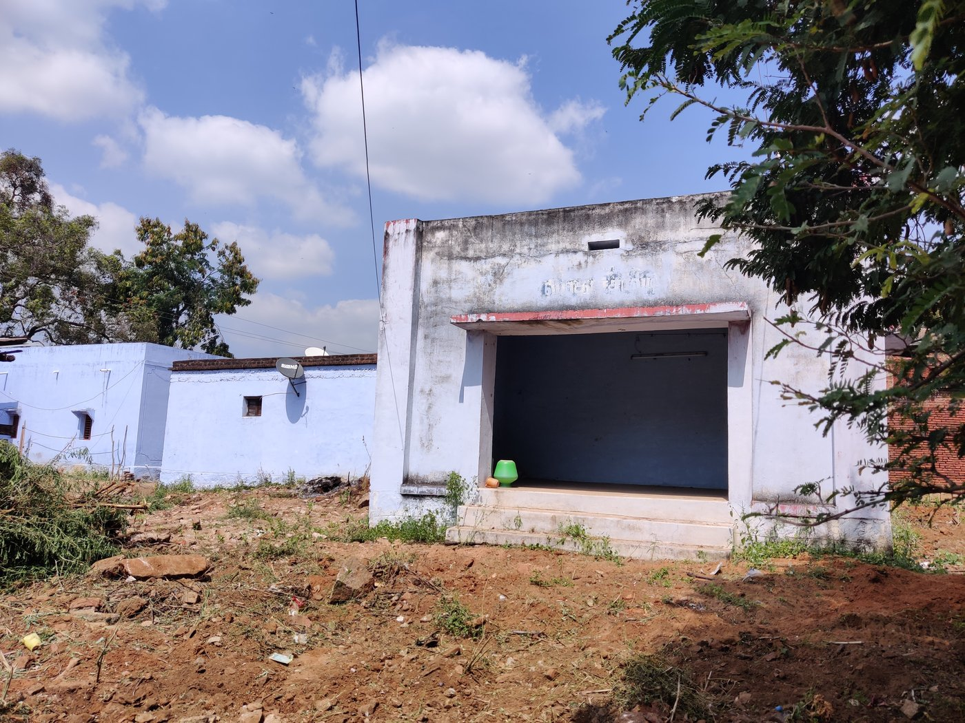 Left: The small, ramshackle muttuthurai in Saptur Alagapuri is located in an isolated spot. Rather than stay here, women prefer camping on the streets when they are menstruating. Right: The space beneath the stairs where Karpagam stays when she menstruates during her visits to the village