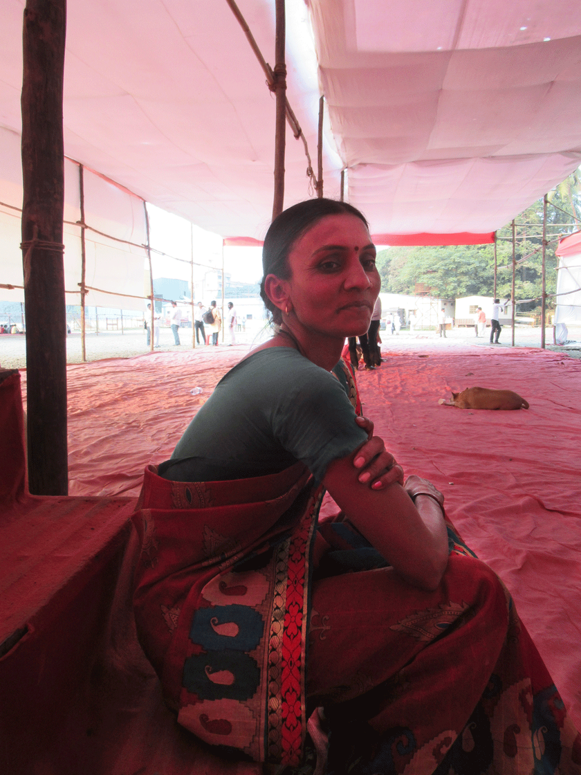 Lone woman sitting under empty pandal