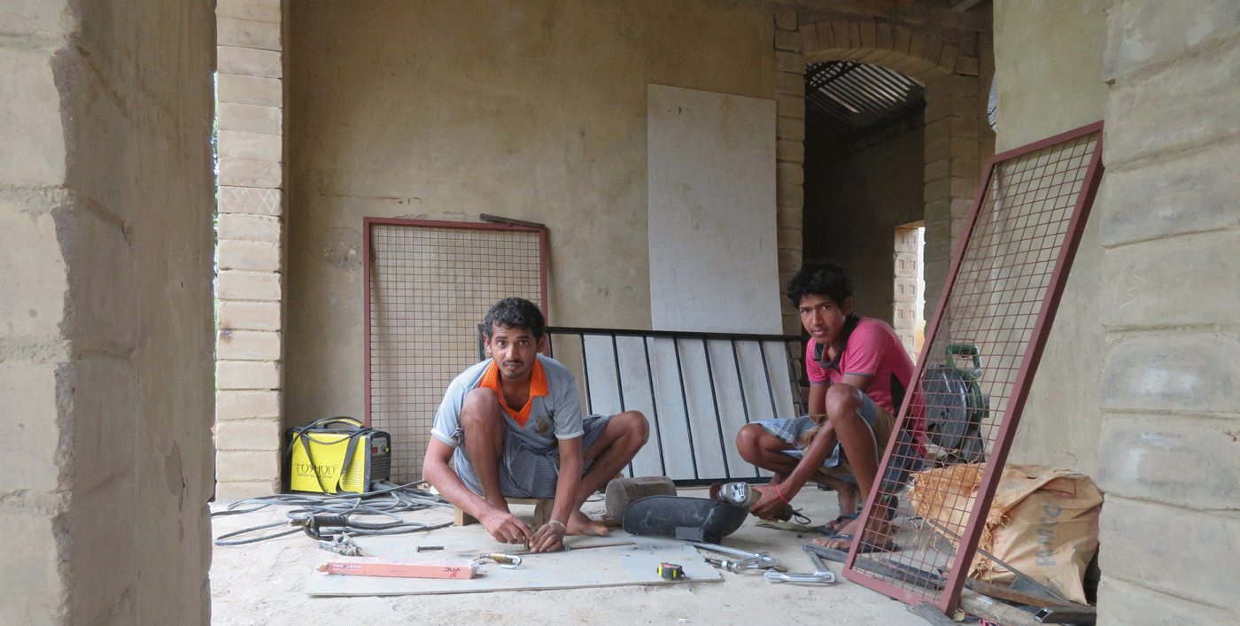 Sriram and Kumar (left to right) working at the new campus