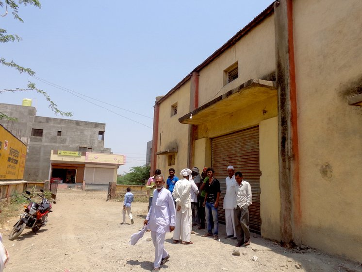 Farmers gathered outside NAFED centre in Kalamb