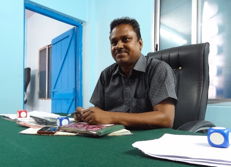 Vinod Meshram, the village development officer, sitting in the modest gram panchayat office of Baranj Mokasa.