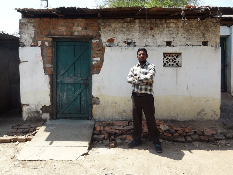 Sachin Chalkhure, a young Dalit activist, standing near his abandoned house.