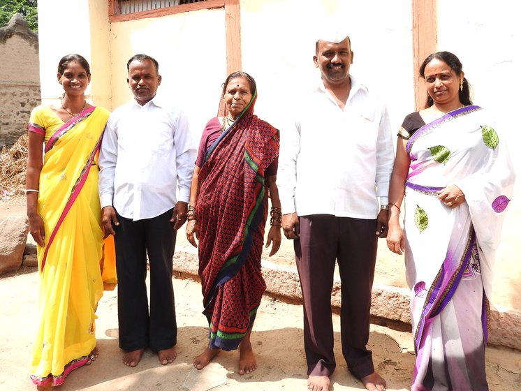 Anjabana bai standing with sons and daughters-in-law outside home