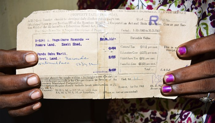 Asha Kaole showing her property tax receipts dating back to 1968