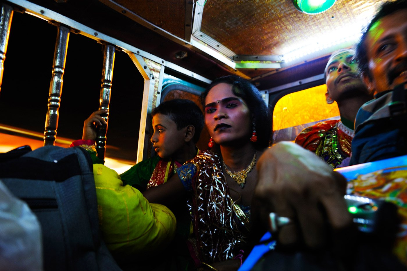 Actors sitting in autorickshaws.