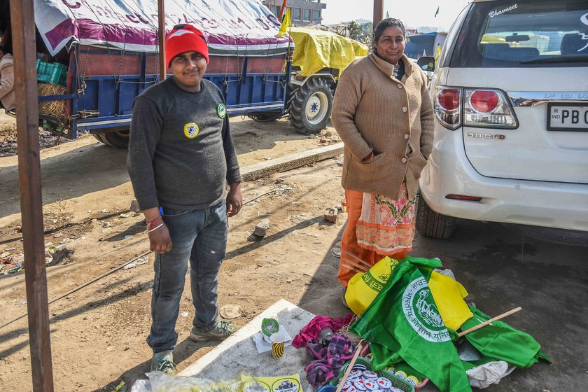 Rita Arora, who sells protest badges, flags and stickers on a street near the Singhu border, says, 'We get our food from farmers. It's impossible to ignore them'