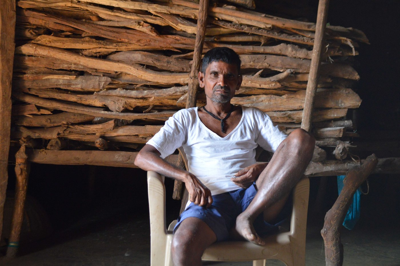 Left: Bhagat Kalu Jangali at his home in Pangri village in Mokhada taluka. Right: Bhagat Subhash Katkari with several of his clients on a Sunday at his home in Deharje village of Vikramgad taluka in Palghar district
