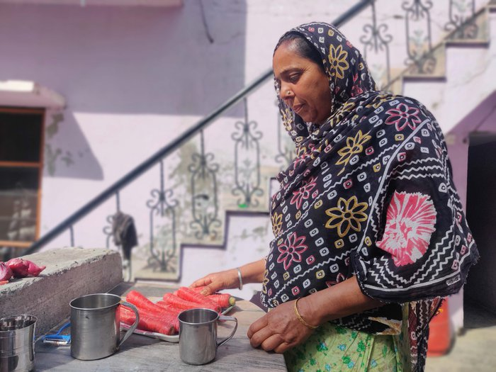 Baljeet Kaur says, the whole village is supporting one another, while cooking