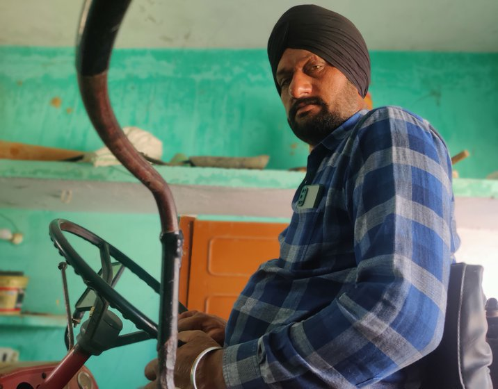 Sukhdev Singh in Saijani village on tractor