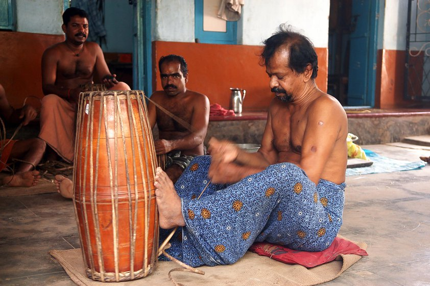Left: K. Manikandan fastens the leather straps of a mridangam. Right: Ramesh and Rajeevan Lakshmanan finish a maddalam