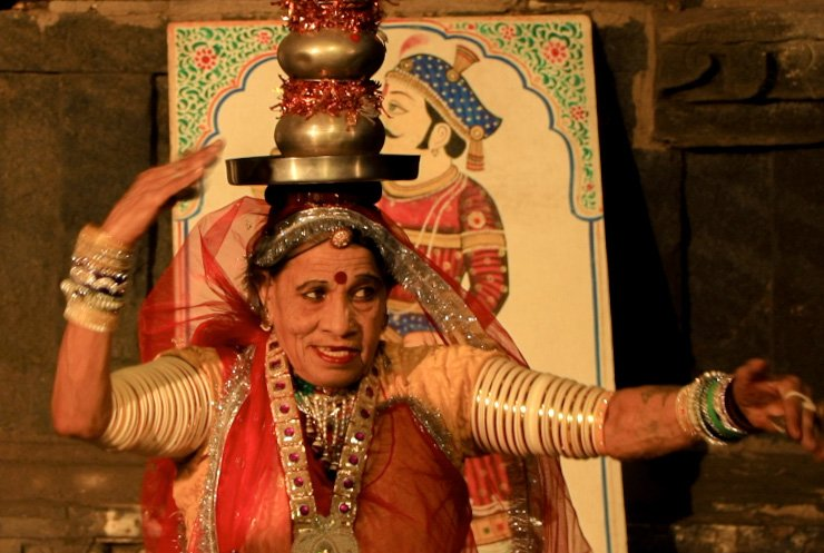 A old women performing traditional Terah Taali dance of Rajasthan
