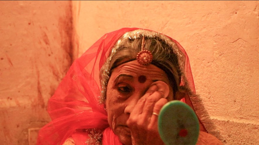 A old women getting ready to perform Terah Taali dance