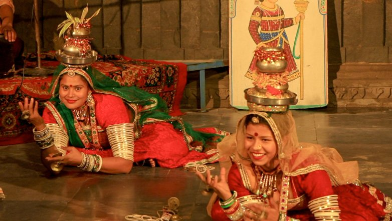 Two women are performing traditional Terah Taali dance Rajasthani dance