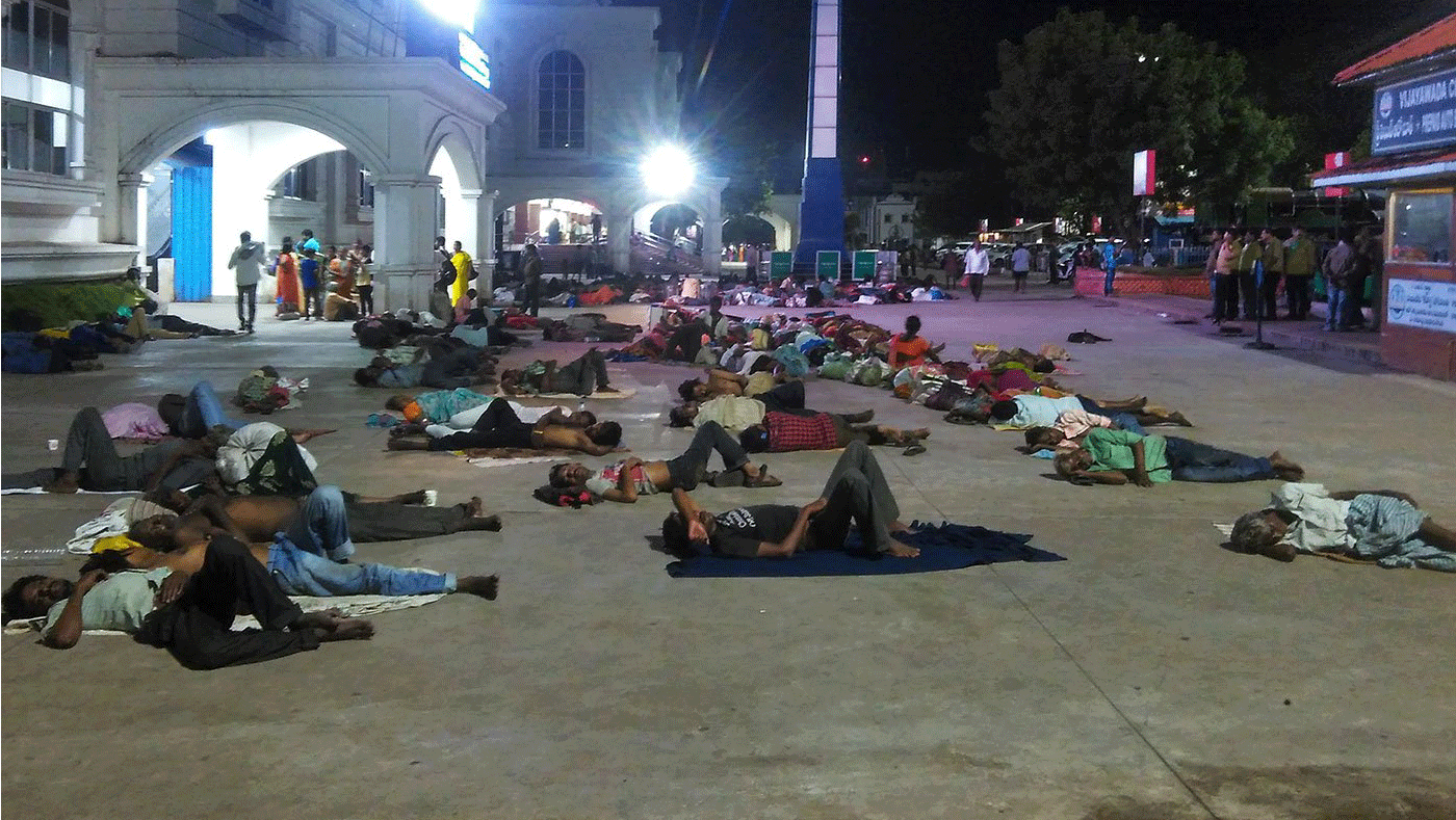 Migrant workers sleep outside railway station