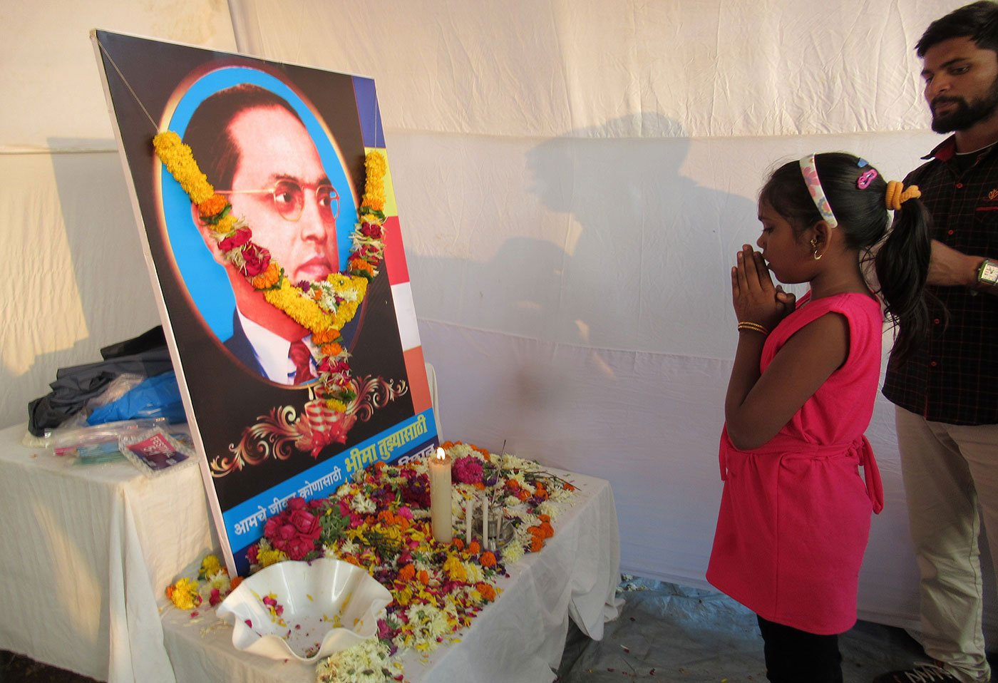 A young girl offers her homage to Babasaheb Ambedkar