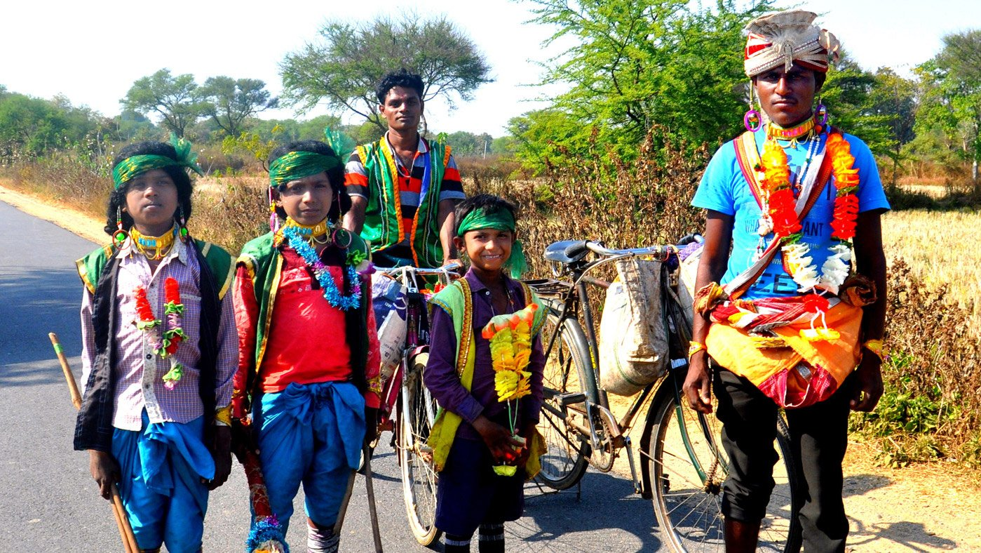 People dressed in colourful costumes on highway