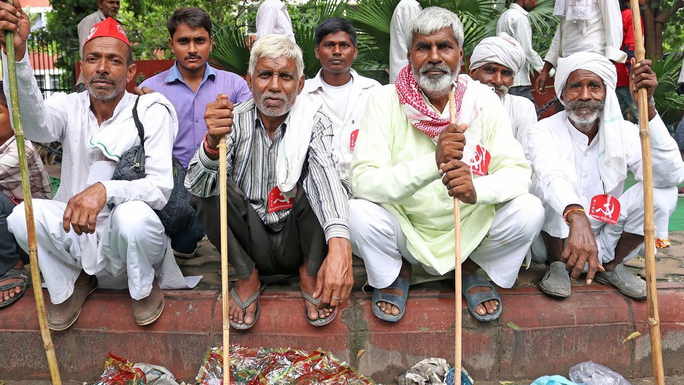 men sitting at a a protest rally