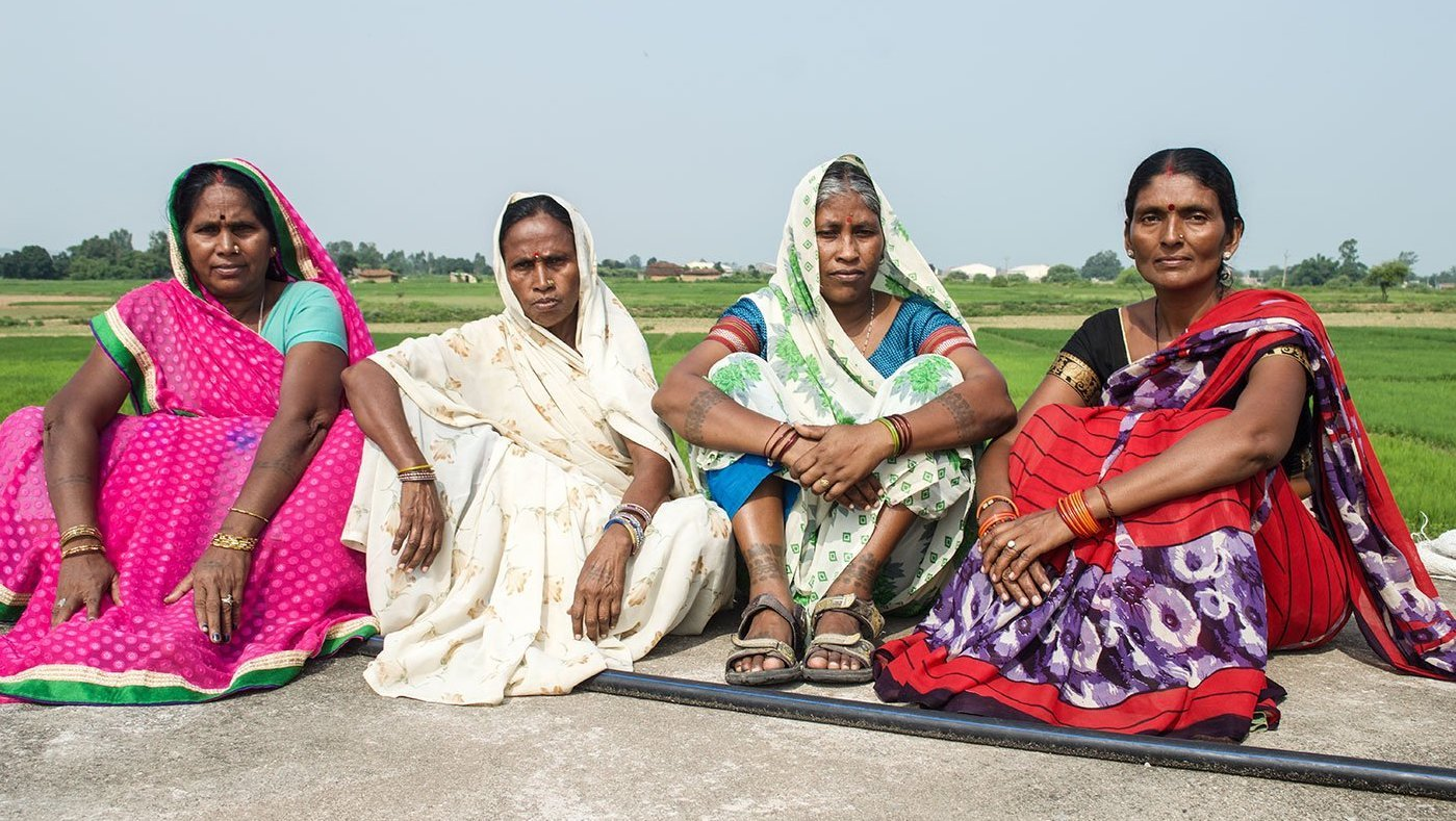 Women sitting in fiield