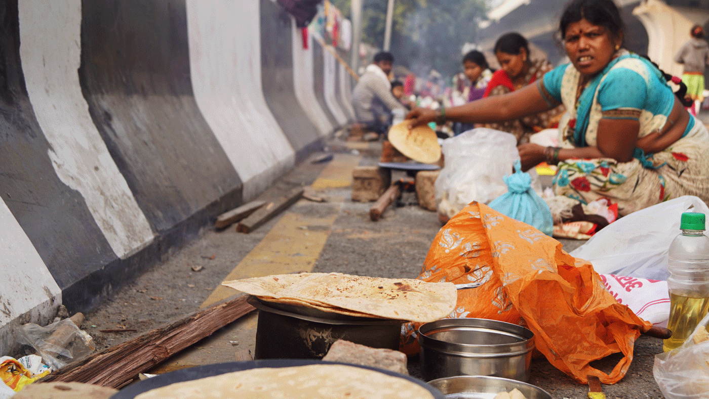 Woman cooking on the street